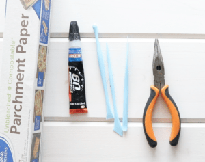 polymer clay tools, glue, pliers and parchment paper, polymer clay earring supplies
