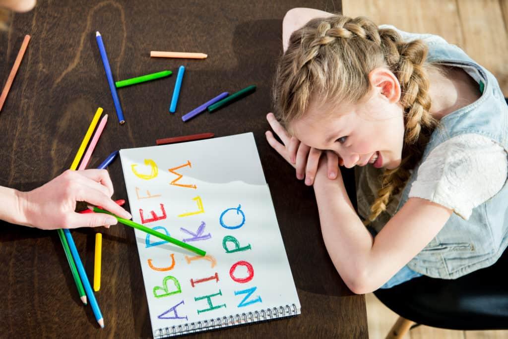 homeschool girl learning alphabet
