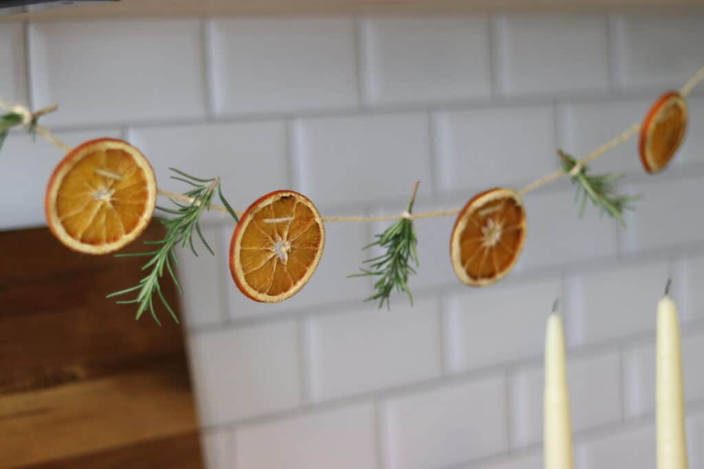 orange garland with beeswax candles