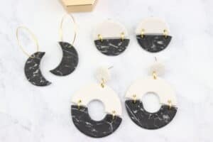 black and white marbled polymer clay earrings with gold jump rings and gold hoops